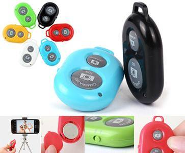 cell phone case: Sell  Bluetooth Remote Shutter  Wireless Controller Selfie Device