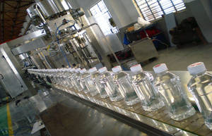 Wholesale round glass liquor bottle: Monoblock Rotary Mineral Water Filling Machine , Beverage Automatic Filling Line