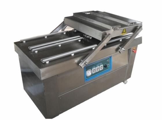 Sell High quality low price fruit and vegetable vacuum packaging machine