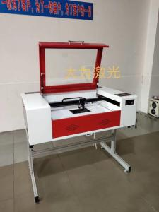 Wholesale garment laser cutting machine: 1390 80W CO2 Laser Cutting Machine / Laser Engraving Machine Made in China